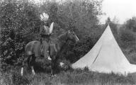 Sinkiuse-Columbia man named Chief Joe Moses on horseback next to tepee, Colville Indian...