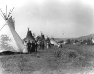 Colville tepees and visitors attending the July 4th celebration, Nespelem, Washington, ca....