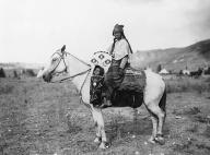 Sinkiuse-Columbia woman on horseback with infant in cradleboard, Washington, ca. 1900-1905.