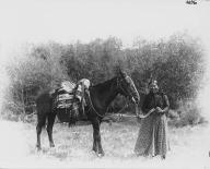 Colville woman with horse, Colville Indian Reservation, Washington, ca. 1900-1910.