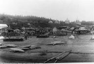 Athapascan canoes & fish racks on beach near Russian mission, Kotlik, Alaska, 1895