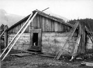 Chilkat cedar plank house with framed doorway, Chilkoot,  Alaska, 1894