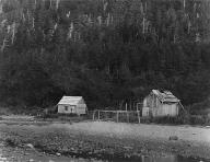 Tlingit houses near beach on Indian Island, near Juneau,  Alaska, 1898
