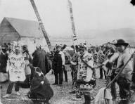 Tlingit dancers at potlatch with painted boards, Klukwan,  Alaska, October 14, 1898