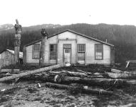 Tlingit house and totem poles belonging to Chief Shakes, Wrangell, Alaska, June 9, 1908.