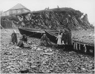 Women cleaning fish on beach, possibly Tlingit, southeastern Alaska, ca. 1906