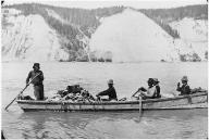 Alaskan packers and miners row boat on Yukon River, Alaska, ca. 1901