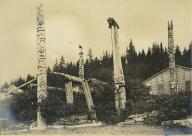 Haida totem poles and house in wooded area, Kasaan, Alaska, ca. 1899