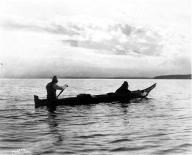 Lummi men trolling for salmon from canoe, near Bellingham, Washington, ca. 1900