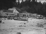 Makah houses and canoes on beach at Neah Bay, Washington, 1911