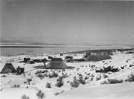 Wanapum tule reed houses in snow, near Priest Rapids, Columbia River, Washington, ca. 1941
