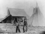 Colville men and boys, house and tepee, Colville, Washington, ca. 1907