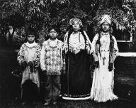 Yakama girl named Ellen Saluskin with her aunt Celicks and two boys, Washington, 1909