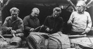 Haida carvers Felix Young, Peter Jones, Walter Young & James Peele work on pole, Kasaan,...