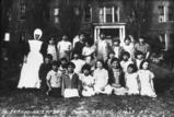 Skitswish girls pose on grass with Sister Seraphina, Sacred Heart Mission, Desmet Idaho, 1937
