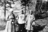 Colville women and man pose near Kettle Falls, Washington