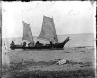 Dugout canoe with two sails, ca. 1900