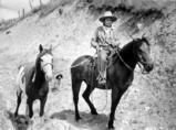 San Poil man named Jim James on horseback