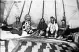 Salish members of the Woodcock family inside tepee, St. Ignatius, Montana, 1924