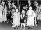 Nez Perce children Beverly Williams, Nathan Ellwood & Dorothy Halfmoon pose in ceremonial...