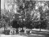 Umatillas men and women stand in Coeur d'Alene Park, Spokane, Washington, 1926