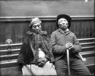 Man and woman, possibly Suquamish, seated inside a Seattle building, ca. 1910