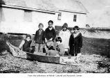 Children with a small canoe, probably on the Makah Indian Reservation
