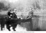 People in a rowboat on Hobuck Lake on the Makah Indian Reservation
