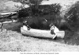 Children in a small canoe, probably on the Makah Indian Reservation