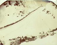 Klondikers ascending Chilkoot Pass with supplies and tents in the foreground , Alaska, spring 1898.