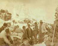 Klondikers with supply caches on the summit of Chilkoot Pass, Alaska, spring 1898.