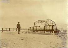 William Steinberger standing at end of Klondike River Bridge, Dawson, Yukon Territory, ca. 1900.