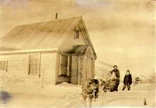 McPhee family with dog team in front of their cabin in West Dawson, Yukon Territory, ca. 1900.