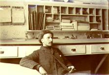 Charles Cullin, purser for the Steamboat VICTORIAN, in the Yukon Dock Company office, Dawson,...