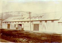 Yukon Dock Company office and warehouse on Front Street, Dawson, Yukon Territory, ca. 1900.