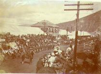 Parade, probably in celebration of Victoria Day, Dawson, Yukon Territory, May 24,1900.