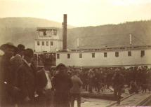Steamboat PROSPECTOR and crowd of men on Dawson dock awaiting her departure, Yukon Territory, ca....