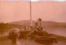 Mabel Meed seated on the bow of the steamboat PROSPECTOR, Yukon Territory, ca. 1901
