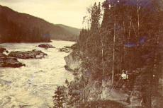 William and Mabel Meed seated on the bank of the Stewart River at Fraser Falls, Yukon Territory,...