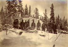 Crew of the steamboat PROSPECTOR outside of tent, probably on lower Lake Laberge, Yukon Territory,...