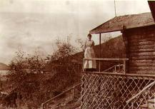 Mabel Meed on the porch of the Meed family cabin in Dawson, Yukon Territory, 1902.