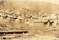 Hillside houses and log cabins, including that of William and Mabel Meed, Dawson, Yukon Territory,...