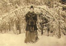 My Lady's Snow-bower; Mabel Meed standing in a spruce forest at the lower end of Lake Laberge,...