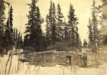 William and Mabel Meed in front of  their log cabin at lower end of Lake Laberge, Yukon Territory,...