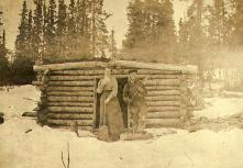 Mabel Meed and her brother-in-law, Richard Meed, in front of the Meed's log cabin at lower Lake...