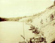 Boats waiting for pilots in order to navigate the Miles Canyon Rapids on the Yukon River, Yukon...