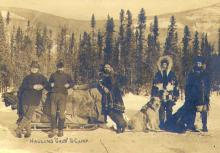 Five men and dogsled team hauling supplies to camp, Yukon Territory, ca. 1899.