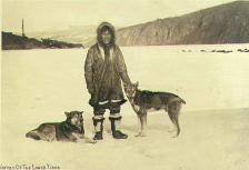 Indian of the lower Yukon dressed in fur parka with two dogs, Yukon Territory, ca. 1900.