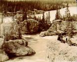 Spectators on cliffs above Five Finger Rapids on the Yukon River, Yukon Territory, ca. 1899.