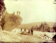 Men portaging scow over an icy portion of the Yukon River at Five Finger Rapids, Yukon Territory,...